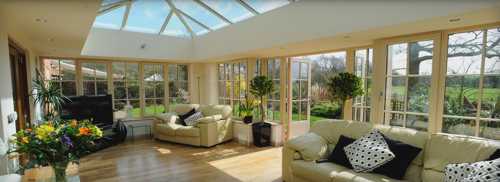 Modern conservatory design with a central apex skylight