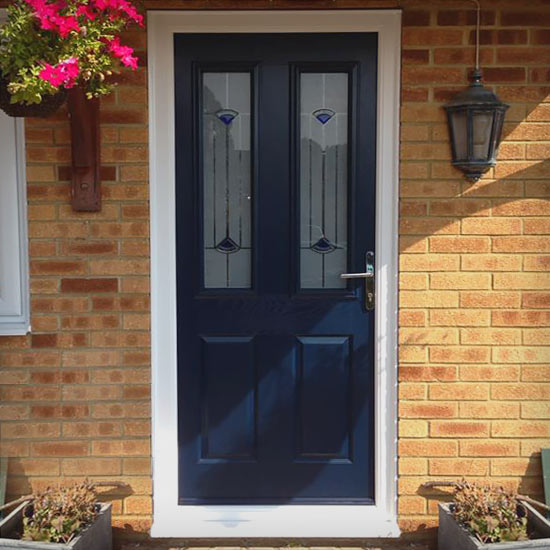 Dark blue composite door with traditional patterned glass panels