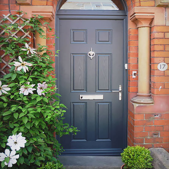Traditional deep blue door with silver fixtures and knocker