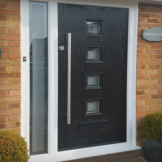 Modern black door with rail handle and 4 square glass panels