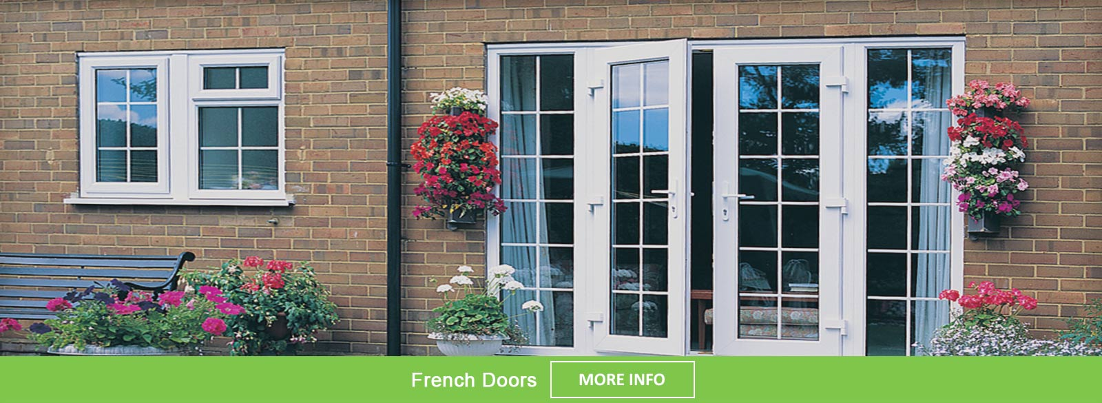White PVC-u French doors viewed from the garden